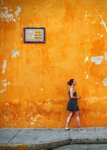 unsplash - Maarten van den Heuvel - woman & orange wall